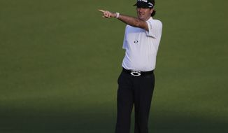 Bubba Watson points to the tee from the first fairway during a practice round for the Masters golf tournament Tuesday, April 9, 2013, in Augusta, Ga. (AP Photo/Darron Cummings)