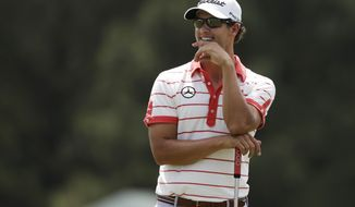 Adam Scott, of Australia, waits to putt on the second green during a practice round for the Masters golf tournament Tuesday, April 9, 2013, in Augusta, Ga. (AP Photo/Darron Cummings)