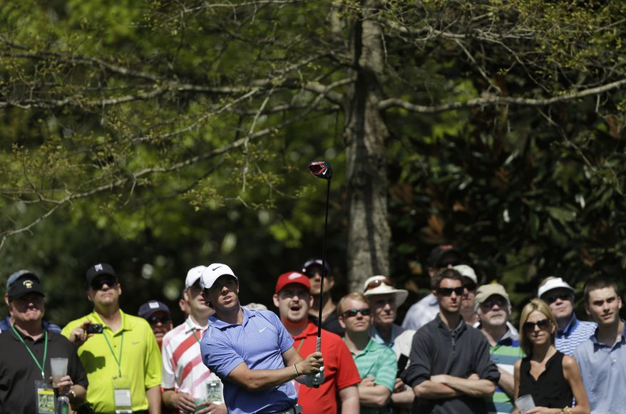 Spectators watch Rory McIlroy, of Northern Ireland, tee shot on the seventh hole during a practice round for the Masters golf tournament Tuesday, April 9, 2013, in Augusta, Ga. (AP Photo/David Goldman)