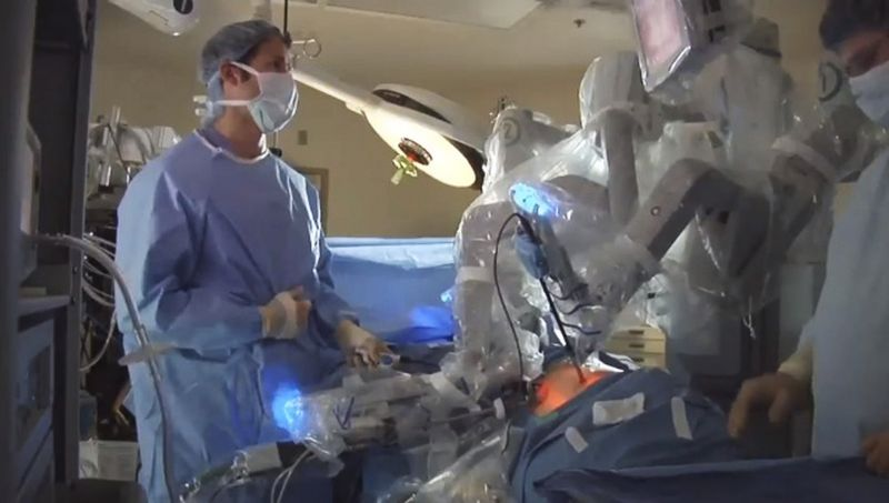 In this photo from video provided by Intuitive Surgical, Inc. of Sunnyvale, Calif., maker of the da Vinci robotic system, doctors are seen using the device to perform a surgery. (Associated Press/Courtesy of Intuitive Surgical, Inc.)