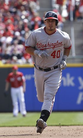 Washington Nationals' Wilson Ramos (40) rounds the bases after hitting a home run against the Cincinnati Reds in a baseball game, Saturday, April 6, 2013, in Cincinnati.