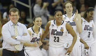 Connecticut players and head coach Geno Auriemma celebrate after defeating Louisville 93-60 in the national championship game of the women's Final Four of the NCAA college basketball tournament, Tuesday, April 9, 2013, in New Orleans. (AP Photo/Dave Martin)