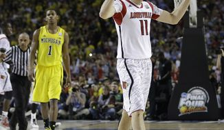 Louisville guard/forward Luke Hancock (11) reacts after Louisville defeated Michigan after the second half of the NCAA Final Four tournament college basketball championship game Monday, April 8, 2013, in Atlanta. Louisville won 82-76. (AP Photo/David J. Phillip)