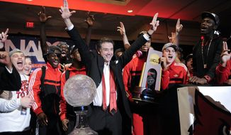 Louisville coach Rick Pitino and team celebrate at the trophy ceremony after winning the NCAA Final Four tournament college basketball championship game against Michigan, Monday, April 8, 2013, in Atlanta. Louisville won 82-76. (AP Photo/John Amis)