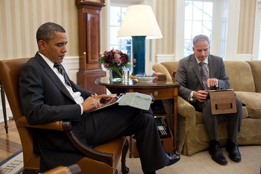 President Barack Obama receives the Presidential Daily Briefing from Robert Cardillo, Deputy Director of National Intelligence for Intelligence Integration, in the Oval Office, Jan. 31, 2012. Part of the briefing was done using a tablet computer. (Official White House Photo by Pete Souza)