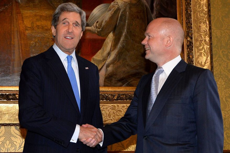 British Foreign Secretary William Hague (right) greets US Secretary of State John Kerry ahead of a meeting in the Foreign and Commonwealth Office in central London, Wednesday April 10, 2013. Kerry is meeting in London with Syrian opposition leaders and Russia's top diplomat, a day after saying the U.S. could soon step up aid to rebels fighting Syrian President Bashar Assad's regime.  Kerry is in London for a G8 foreign ministers' meeting today and Thursday. (AP Photo/Ben Stansall, pool)