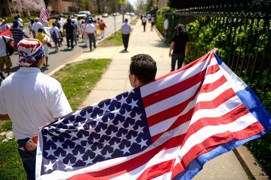 About 200 people marched down 16th Street from Columbia Heights to join others for the National Rally for Citizenship. (Andrew Harnik/The Washington Times)