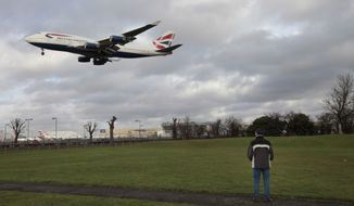 A British Airways Boeing 747 jetliner lands at London's Heathrow Airport on Monday, Jan. 10, 2011. (AP Photo/Lefteris Pitarakis)