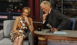 """Actress Lindsay Lohan talks with David Letterman about her upcoming stint in rehab, her guest-star role in the series """"Anger Management"""" and her film """"Scary Movie 5"""" during the taping of the """"Late Show With David Letterman"""" in New York on Tuesday, April 9, 2013. (AP Photo/CBS Entertainment, Jeffrey R. Staab)"""