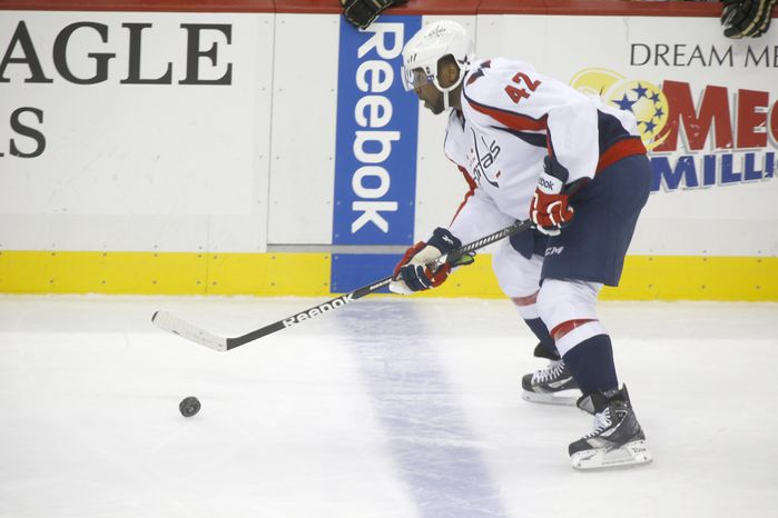 Washington Capitals' Joel Ward (42) plays in the NHL hockey game between the Pittsburgh Penguins and the Washington Capitals on Thursday, Feb. 7, 2013 in Pittsburgh. (AP Photo/Keith Srakocic)