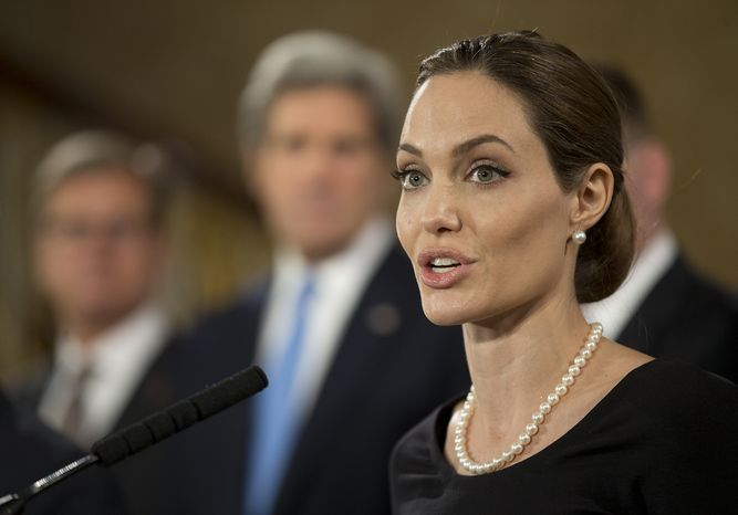 Backed by Group of Eight foreign ministers, American actress Angelina Jolie, in her role as United Nations envoy for refugees, addresses sexual violence against women in conflict, in London on Thursday, April 11, 2013. (