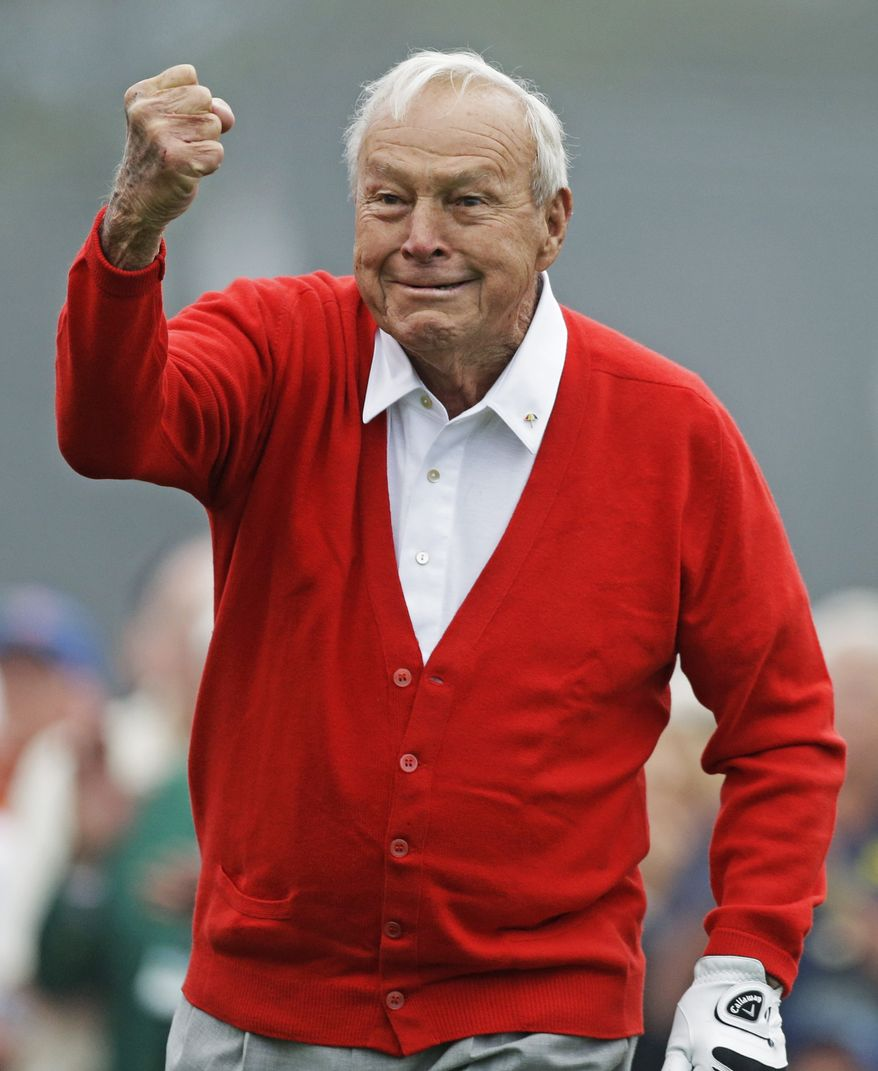Honorary starter Arnold Palmer punches the air after hitting off the first tee before the first round of the Masters golf tournament Thursday, April 11, 2013, in Augusta, Ga. (AP Photo/David Goldman)