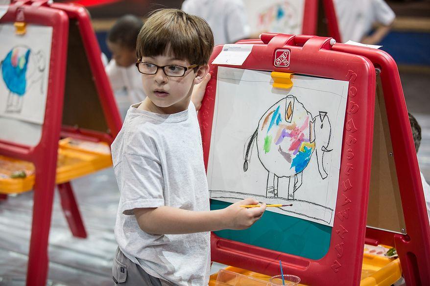 Leonte Castillo, from the Young Rembrandts, a school art program, paints a picture of an elephant at George Mason University Patriot Center, in Fairfax, VA., Thursday, April 11, 2013. (Andrew S Geraci/The Washington Times)