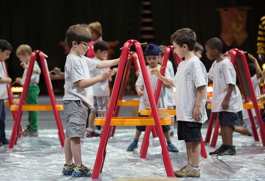 Leonte Castillo (left) and Ellis Abdelhandi (right), children from the Young Rembrandts, a school art program, paint a picture of an elephant at George Mason University Patriot Center, in Fairfax, VA., Thursday, April 11, 2013. (Andrew S Geraci/The Washington Times)