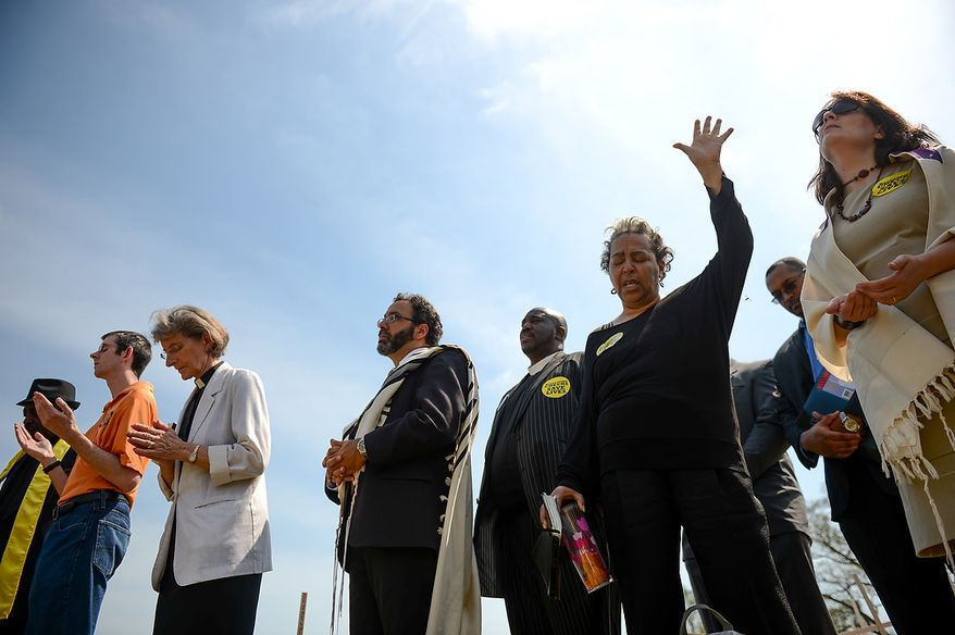 Religious leaders around the country begin a 24-hour vigil on the National Mall to honor the victims of gun violence since the school shooting in Newtown, Conn., Washington, D.C., Thursday, April 11, 2013.(Andrew Harnik/The Washington Times)
