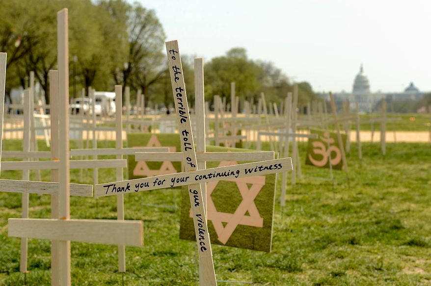 Thousands of grave markers representing victims of gun violence are placed on the National Mall, Washington, D.C., Thursday, April 11, 2013. Religious leaders around the country begin a 24-hour vigil to honor the victims of gun violence since the shooting in Newtown.(Andrew Harnik/The Washington Times)