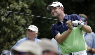 Marc Leishman, of Australia, reacts to his tee shot on the 18th hole during the first round of the Masters golf tournament Thursday, April 11, 2013, in Augusta, Ga. (AP Photo/David J. Phillip)