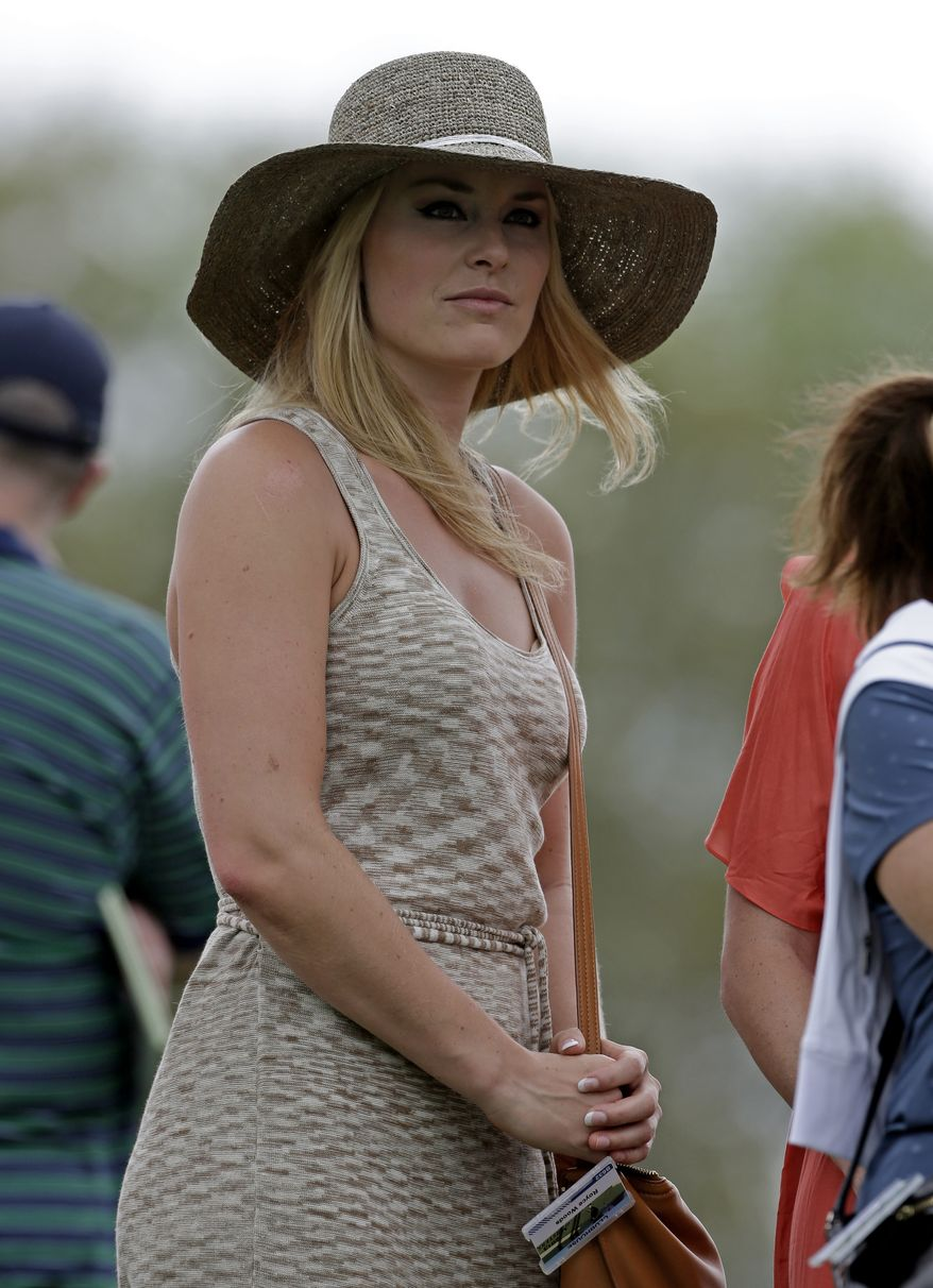 Skier Lindsey Vonn watches Tiger Woods during the first round of the Masters golf tournament Thursday, April 11, 2013, in Augusta, Ga. (AP Photo/Darron Cummings)