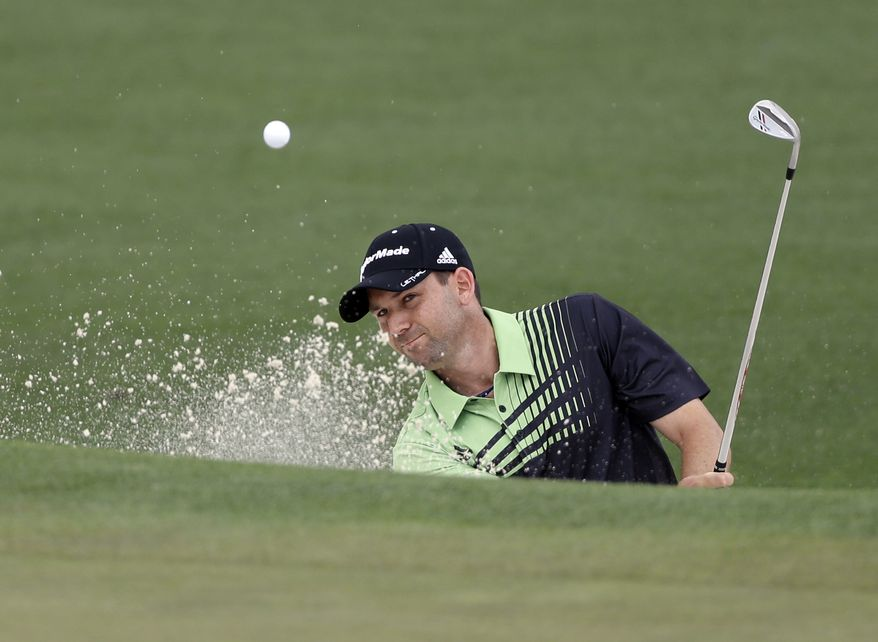 Sergio Garcia, of Spain, chips out of a bunker on the second green during the first round of the Masters golf tournament Thursday, April 11, 2013, in Augusta, Ga. (AP Photo/David Goldman)