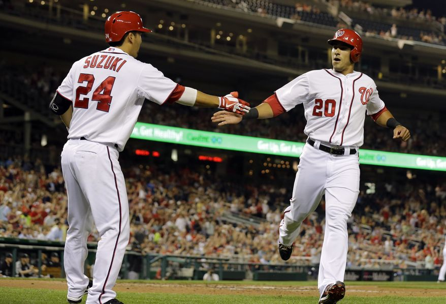 Ian Desmond is congratulated by Kurt Suzuki in the Washington Nationals win over the Chicago White Sox. (Associated Press photo)