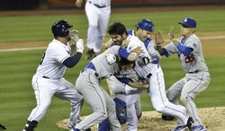 San Diego Padres' Carlos Quentin, center, and teammates battle the Los Angeles Dodgers after Quentin was hit by a pitch thrown by Angeles Dodgers pitcher Zack Greinke in the sixth inning of baseball game in San Diego, Thursday, April 11, 2013. (AP Photo/Lenny Ignelzi)