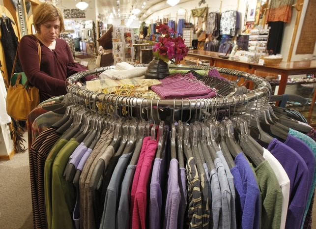 **FILE** A shopper looks over the clothes at the Vermont Trading Company in Montpelier, Vt., on Tuesday, A