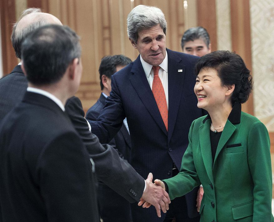 U.S. Secretary of State John Kerry (center) introduces South Korean President Park Geun-hye (left) to his senior staff members as they meet at the presidential Blue House in Seoul on April 12, 2013. (Associated Press)