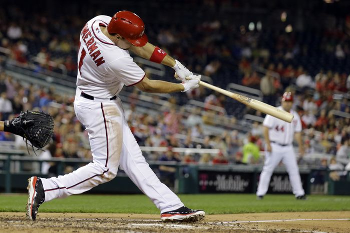 Ryan Zimmerman hits a two-RBI double during the fourth inning of an interleague baseball game against the Chicago White Sox at Nationals Park. Bryce Harper was intentionally walked to bring Zimmerman to the plate. (Associated Press photo)