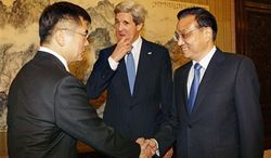 U.S. Secretary of State John Kerry, center, looks on as U.S. Ambassador to China Gary Locke, left, shakes hands with China's Premier Li Keqiang during a meeting at the Zhongnanhai compound in Beijing Saturday, April 13, 2013. (Associated Press)