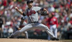 Atlanta Braves pitcher Tim Hudson delivers a pitch during the fifth inning of a baseball game against the Washington Nationals at Nationals Park on Saturday, April 13, 2013, in Washington. (AP Photo/Evan Vucci)