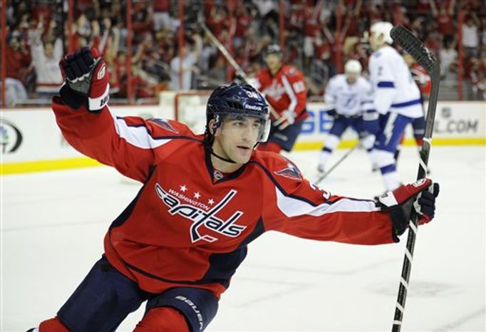 Washington Capitals defenseman Jack Hillen (38) celebrates his goal against the Tampa Bay Lightning during the first period of an NHL hockey game, Saturday, April 13, 2013, in Washington. (AP Photo/Nick Wass)
