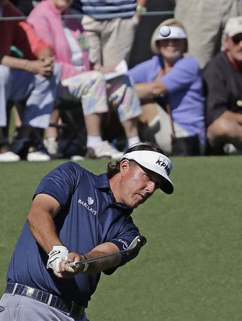 Phil Mickelson chips to the second green during the third round of the Masters golf tournament Saturday, April 13, 2013, in Augusta, Ga. (AP Photo/David J. Phillip)