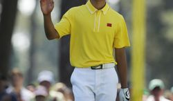 Amateur Guan Tianlang, of China, during the third round of the Masters golf tournament Saturday, April 13, 2013, in Augusta, Ga. (AP Photo/Charlie Riedel)