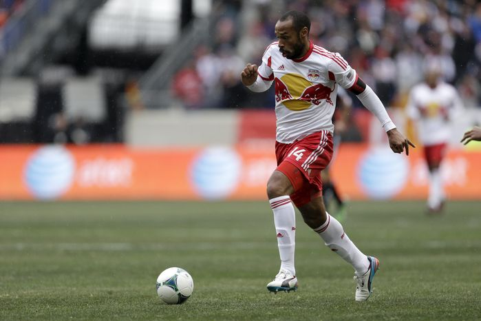 **FILE** New York Red Bulls forward Thierry Henry dribbles the ball during the first half of an MLS soccer game against the D.C. United, Saturday, March 16, 2013, in Harrison, N.J. (AP Photo/Julio Cortez)