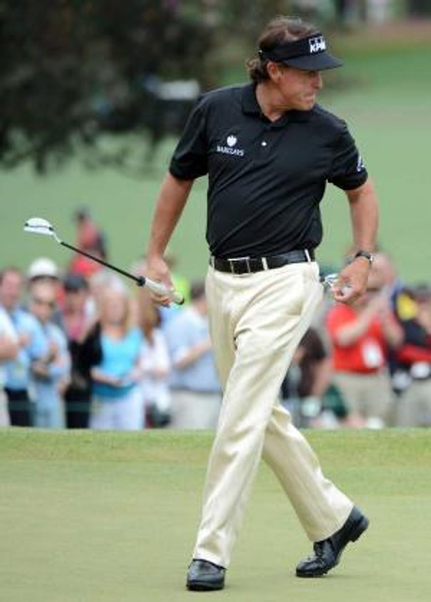 Phil Mickelson looks back after putting on No. 7 during the final round of the 2013 Masters Tournament. (Emily Rose Bennett/The Augusta Chronicle)