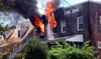 A photo posted on the Twitter page of the D.C. Firefighters Association shows a Northeast blaze that injured two people Sunday.