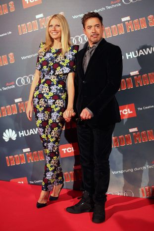 """U.S actors Robert Downey Jr. (right) and Gwyneth Paltrow pose for photographers during the """"Iron Man 3"""" premiere in Paris on Sunday, April 14, 2013. (AP Photo/Thibault Camus)"""