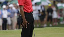 Tiger Woods reacts after missing a par putt on the seventh green during the fourth round of the Masters golf tournament Sunday, April 14, 2013, in Augusta, Ga. (AP Photo/David J. Phillip)