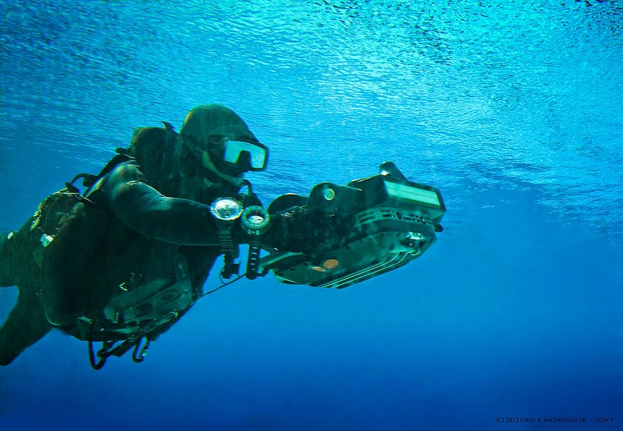 A U.S. Navy SEAL using a computerized  HMU underwater to take measurements of a beach landing area. Photo: (C) 2011 Greg E. Mathieson Sr. / NSW Publications, LLC