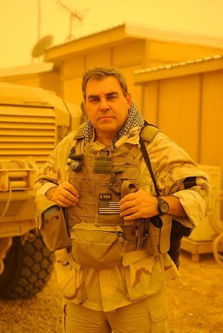 Author and photographer, Greg E. Mathieson Sr. stands in a dust storm at the secluded US Navy SEAL base in Fallujah, Iraq while producing exclusive material for the newly released book, US Naval Special Warfare / US Navy SEALs.  Photo: (C) 2011 Gre