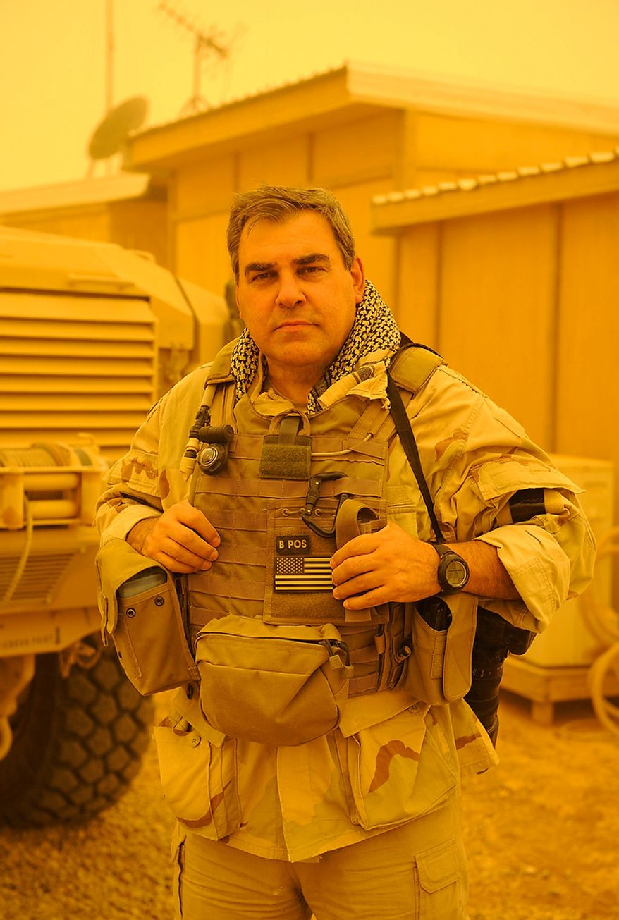Author and photographer, Greg E. Mathieson Sr. stands in a dust storm at the secluded US Navy SEAL base in Fallujah, Iraq while producing exclusive material for the newly released book, US Naval Special Warfare / US Navy SEALs.  Photo: (C) 2011 Greg E. Mathieson Sr. / NSW Publications, LLC