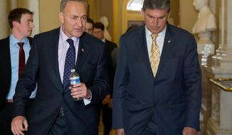Sen. Joe Manchin III (right), West Virginia Democrat, tempered a proposal by Sen. Charles E. Schumer, New York Democrat, that would have expanded checks to virtually all private gun sales. (Associated Press)