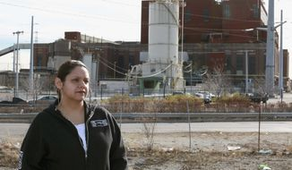 ** FILE ** This Dec. 4, 2012, photo provided by The Goldman Environmental Prize shows Kimberly Wasserman Nieto, of Chicago, standing outside Midwest Generation's Crawford Generating Station in Chicago. (AP Photo/Courtesy of The Goldman Environmental Prize, Jennifer Walton)