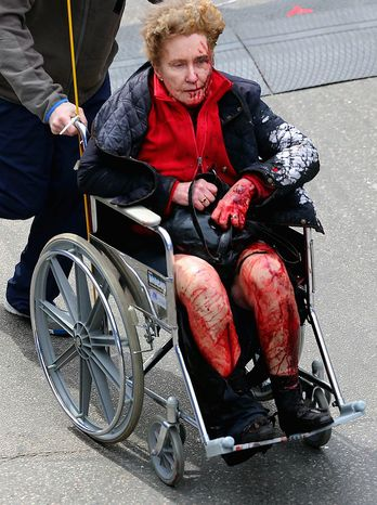 Medical workers aid an injured person at the 2013 Boston Marathon following an explosion in Boston, Monday, April 15, 2013. Two explosions shattered the euphoria of the Boston Marathon finish line on Monday, sending author