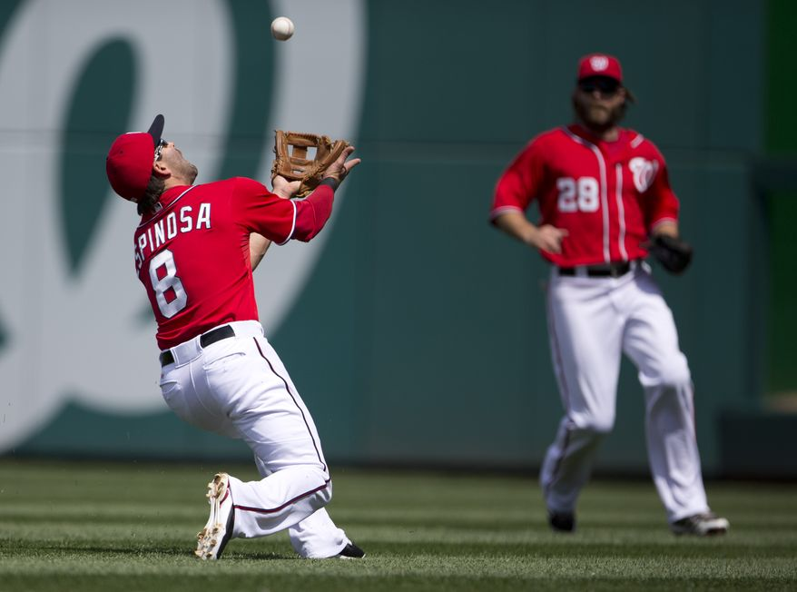 Washington Nationals second baseman Danny Espinosa ranges back to catch a ball as right fielder Jayson Werth looks on. (Associated Press photo)