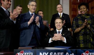 ** FILE ** New York Gov. Andrew Cuomo and legislative leaders applaud after Cuomo signed New York's Secure Ammunition and Firearms Enforcement Act into law during a ceremony in the Red Room at the Capitol on Jan. 15, 2013, in Albany, N.Y. From left are Senate co-leader Jeffrey Klein, Bronx Democrat, Assembly Speaker Sheldon Silver, Manhattan Democrat, Lt. Gov. Robert Duffy (behind Cuomo) and Senate Democratic Leader Andrea Stewart-Cousins, Yonkers Democrat. (Associated Press)