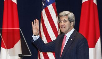 U.S. Secretary of State John Kerry waves to the crowd as he enters the auditorium to deliver a policy speech on the 21st Century Pacific Partnership at Tokyo Institute of Technology in Tokyo, Japan, Monday, April 15, 2013. Kerry is in Tokyo as part of Asian tour amid a tense situation over a possible missile launch by North Korea. (AP Photo/Paul J. Richards, Pool)