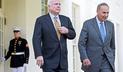 Sens. John McCain, Arizona Republican, and Charles E. Schumer, New York Democrat, leave the White House after a meeting with President Obama on immigration. (Associated Press)