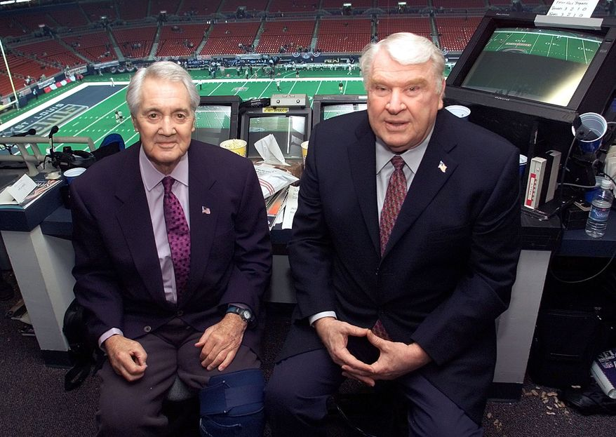 **FILE** Pat Summerall and John Madden in the FOX broadcast booth before the NFC divisional playoff in this Jan. 20, 2002 photo in St. Louis. (AP Photo/Michael Conroy)