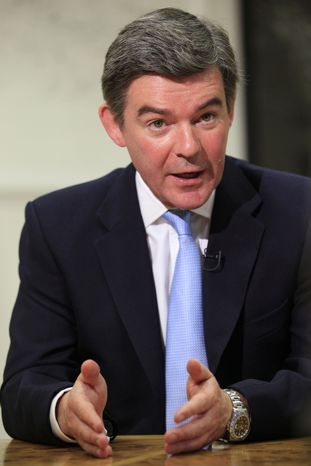 "British sports minister Hugh Robertson, shown here in a July 26, 2011 file photo, said Britain ""won't be cowered by this sort of behavior"" in announcing that Sunday's London Marathon will go on in the wake of Monday's bombings at the Boston Marathon. (AP Photo/Sang Tan)"